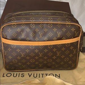 Louis Vuitton cross body travel bag